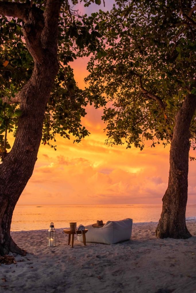 CapKaroso-Beach-sunset-loungechair-trees-2