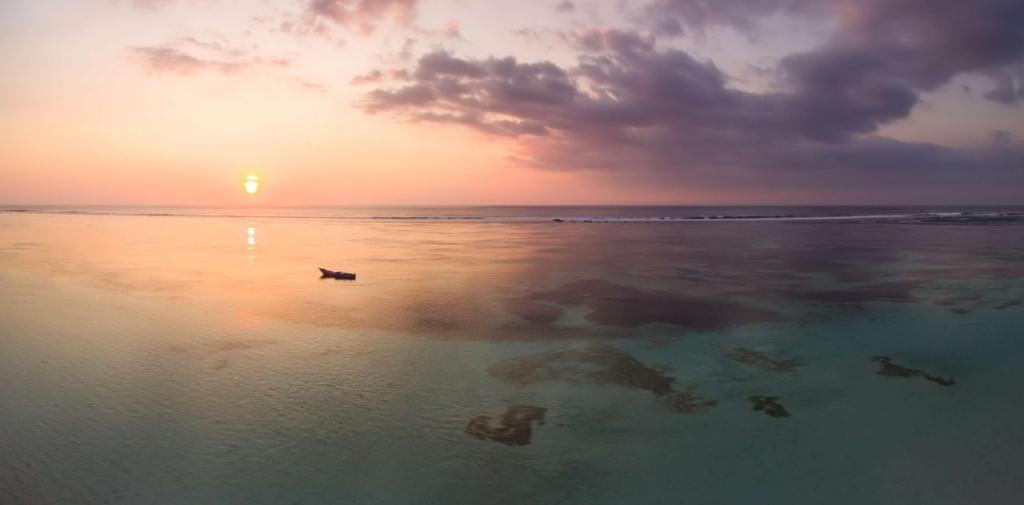 CapKaroso-KarosoLagoon-sunset-boat