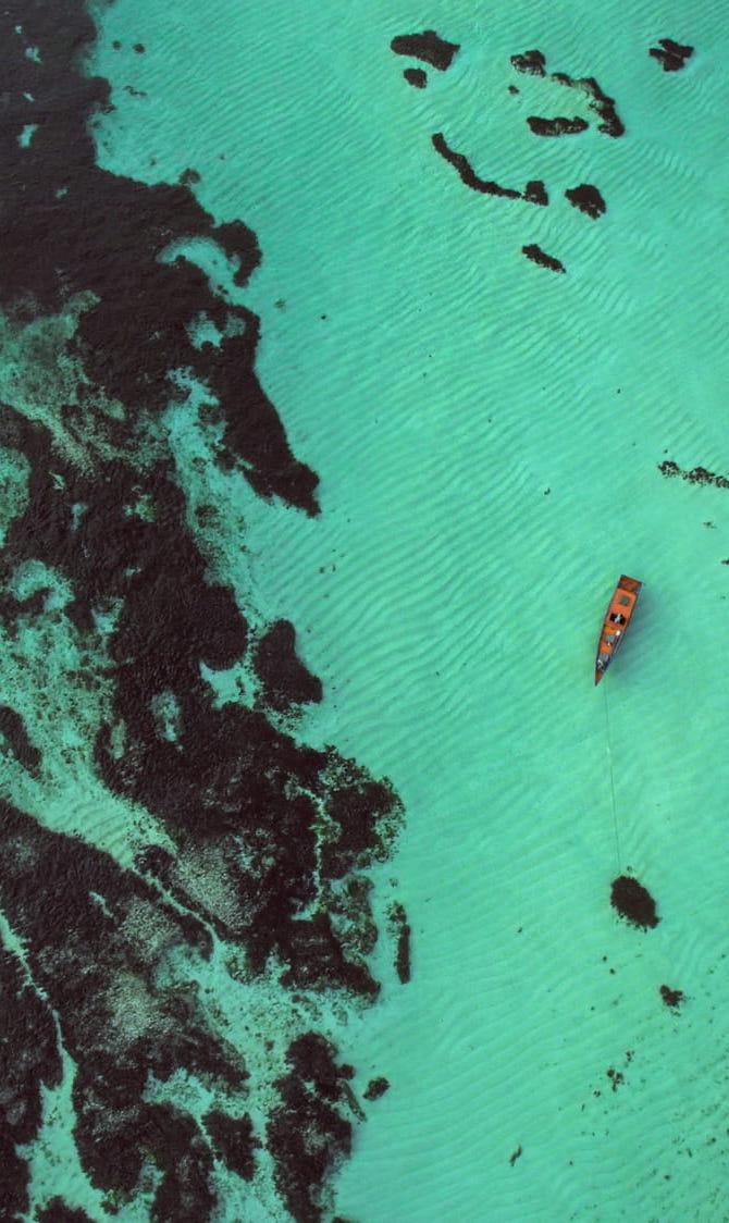 Emerald Karoso Lagoon with boat
