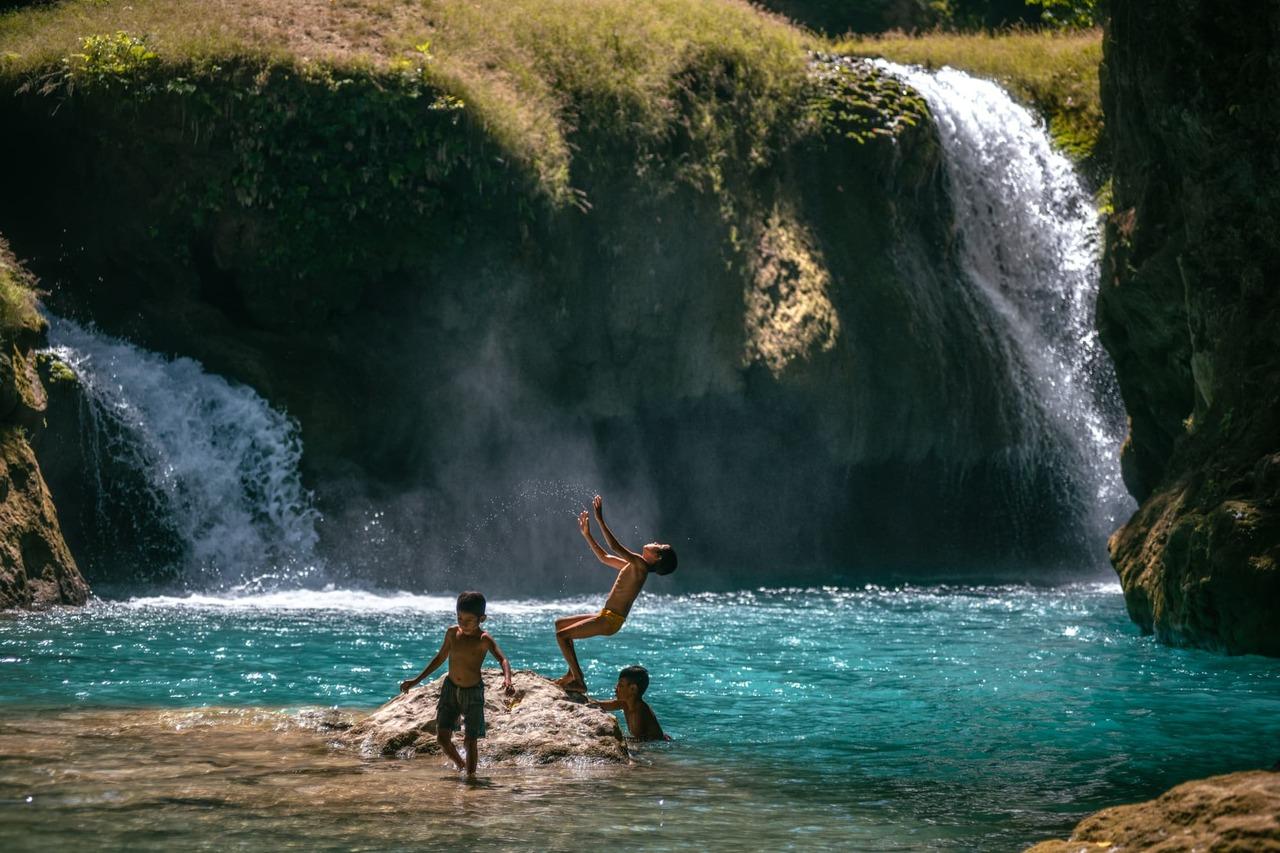 CapKaroso-children-jumping-lagoon-waterfalls