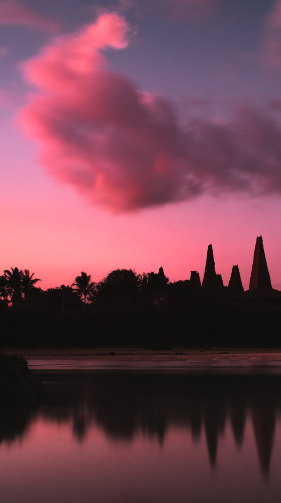 Pink sunset over traditional village