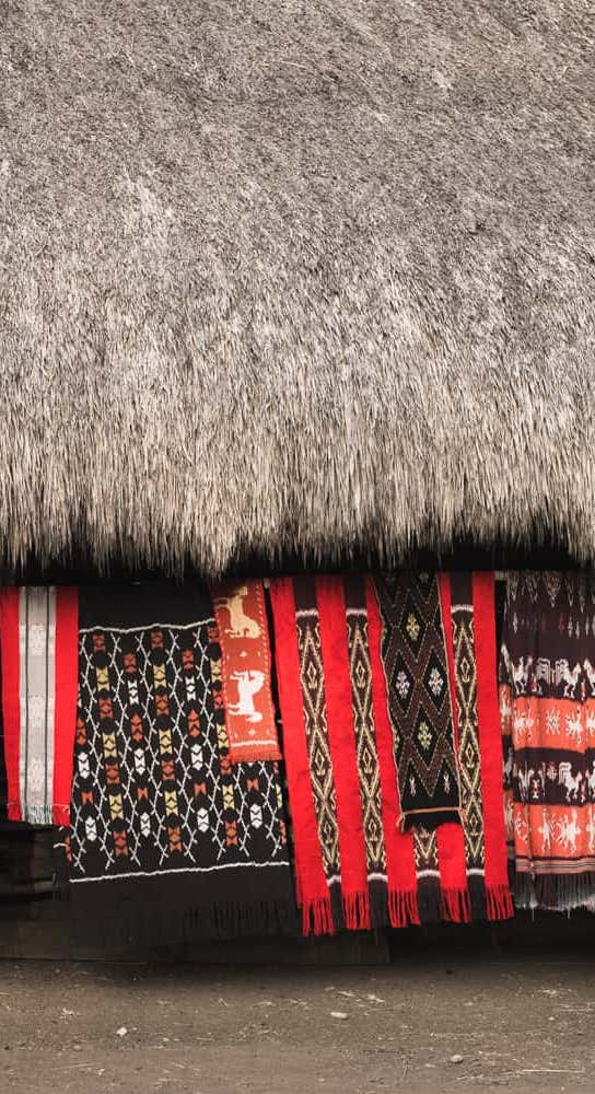 Red Ikat hanging in front of traditional house