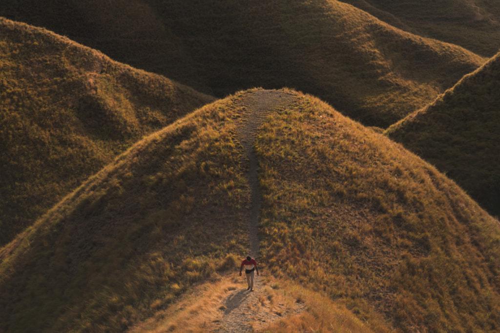 Man-walking-hill-sunset