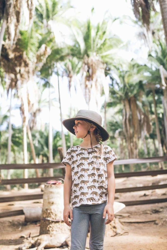 little girl wearing explorer hat